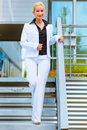 Smiling business woman walking down stairs Royalty Free Stock Photo