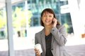 Smiling business woman walking and talking on cell phone Royalty Free Stock Photo