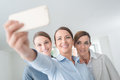 Smiling business women team taking a selfie Royalty Free Stock Photo
