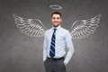 Smiling businessman with angel wings and nimbus Royalty Free Stock Photo