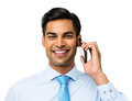 Smiling businessman answering smart phone portrait of against white background horizontal shot Royalty Free Stock Photos