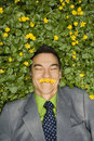 Smiling Businessman in Flower Patch Royalty Free Stock Photo