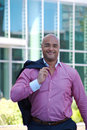 Smiling businessman in front of glass building Royalty Free Stock Photo