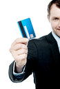 Smiling businessman holding credit card Royalty Free Stock Photo