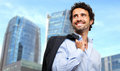 Smiling businessman holding his jacket outdoor Stock Photo