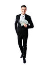 Smiling businessman holding us dollars full length portrait of a isolated on a white background Stock Photos
