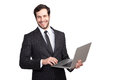 Smiling businessman with a laptop handsome to camera gray in his hand isolated Stock Photo