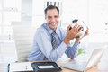 Smiling businessman looking at camera with foot ball Royalty Free Stock Photo
