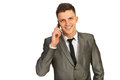 Smiling businessman by phone Royalty Free Stock Photo