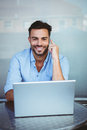 Smiling businessman on the phone working on laptop Royalty Free Stock Photo