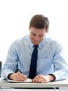 Smiling businessman signing papers in office Royalty Free Stock Photo