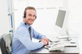 Smiling businessman speaking with headset Royalty Free Stock Photo
