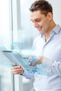 Smiling businessman with tablet pc in office business technology internet and concept computer Royalty Free Stock Photo