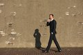 Smiling businessman walking and talking on mobile phone Royalty Free Stock Photo