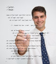 Smiling businessman writing in sql language on a transparent board Stock Photos