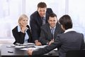 Smiling businesspeople meeting looking executive office Stock Photo
