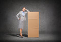 Smiling businesswoman with cardboard boxes business post and transportation concept tower of Stock Photography