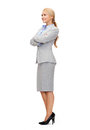 Smiling businesswoman with crossed arms Stock Photo