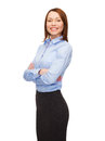 Smiling businesswoman with crossed arms Stock Photography