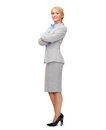 Smiling businesswoman with crossed arms business and education concept friendly young Royalty Free Stock Photos