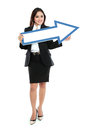 Smiling businesswoman with direction arrow sign on white background Stock Photo