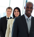 Smiling businesswoman in focus with her team in a Royalty Free Stock Photo