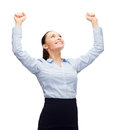 Smiling businesswoman with hands up business success and office concept hads Stock Photography