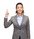 Smiling businesswoman with her finger up business and advertisement concept attractive young woman Stock Image