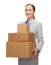 Smiling businesswoman holding cardboard boxes business and delivery service concept Royalty Free Stock Photos