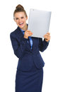 Smiling businesswoman holding file up next to face Royalty Free Stock Photo