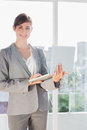 Smiling businesswoman holding laptop and looking at camera Royalty Free Stock Image