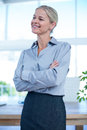 Smiling businesswoman looking away in an office Royalty Free Stock Photography