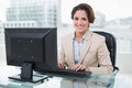 Smiling businesswoman looking at camera in bright office Stock Images