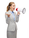 Smiling businesswoman with megaphone business communication and office concept Royalty Free Stock Images