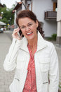 Smiling businesswoman on phone calls with your cell phone Royalty Free Stock Photo