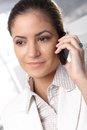 Smiling businesswoman on phone confident concentrating mobile call Royalty Free Stock Images