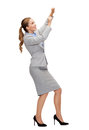 Smiling businesswoman pulling imaginary rope business and education concept Royalty Free Stock Image