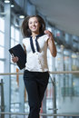 Smiling businesswoman runs towards camera Royalty Free Stock Photo