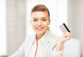 Smiling businesswoman showing credit card Royalty Free Stock Photo