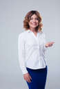 Smiling businesswoman standing over gray background Royalty Free Stock Photo