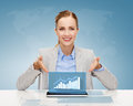 Smiling businesswoman with tablet pc business technology internet and office concept computer and increasing chart Royalty Free Stock Photos