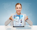 Smiling businesswoman with tablet pc business technology internet and office concept computer and news on virtual screen Royalty Free Stock Image