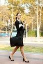 Smiling businesswoman walking Royalty Free Stock Photo