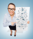 Smiling businesswoman with white board with plan business and advertisement concept in eyeglasses pointing finger to big Stock Photography