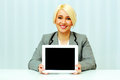 Smiling businesswoman woman showing display of a tablet computer young in office Royalty Free Stock Photos