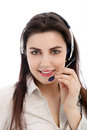 Smiling call center agent with headphone in a close up portrait Royalty Free Stock Photo