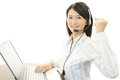 Smiling call center operator Stock Images