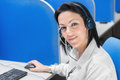 Smiling call center operator girl sitting at desk with computer Royalty Free Stock Photo