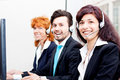 Smiling callcenter agent with headset support Royalty Free Stock Photos
