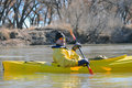 Smiling canoeist on river Stock Image